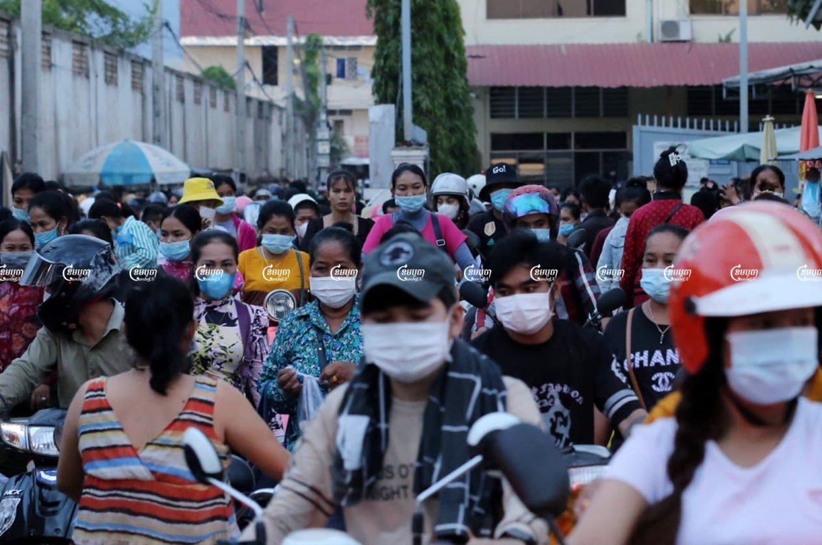 Garment workers leave a factory after finished their work on the outskirts of Phnom Penh, Picture taken on August 18, 2021. CamboJA/ Panha Chhorpoan