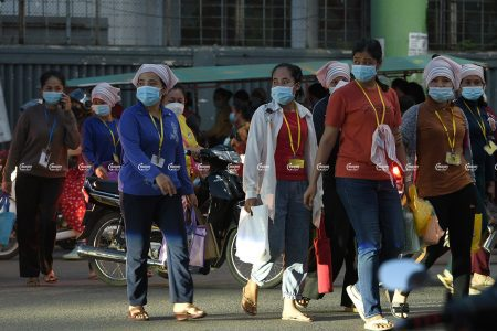 Garment workers leave a factory after finishing their work in Phnom Penh, September 21, 2021. CamboJA/ Panha Chhorpoan