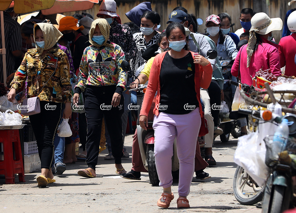 Garment workers leave for their lunch break from a factory on the outskirts of Phnom Penh, September 28, 2021. CamboJA/ Pring Samrang