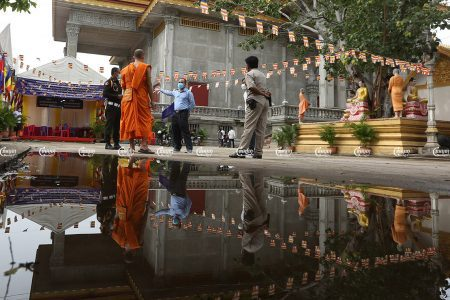 Health officers and authorities speak with a monk at a pagoda to discuss rapid COVID-19 testing, on the third day of Pchum Ben in Phnom Penh, September 24, 2021. CamboJA/ Pring Samrang