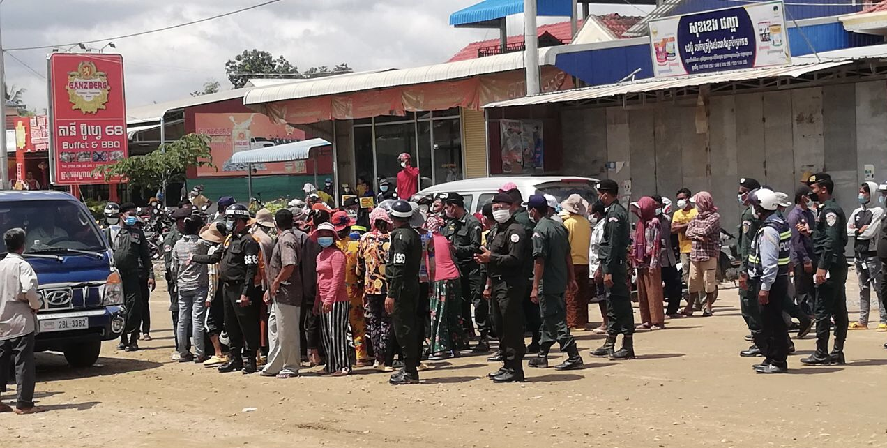 Police prevent villagers from protesting at National Road 2 amid a land dispute over the newly planned airport in Kandal Stung district on September 7, 2021. Photo Supplied
