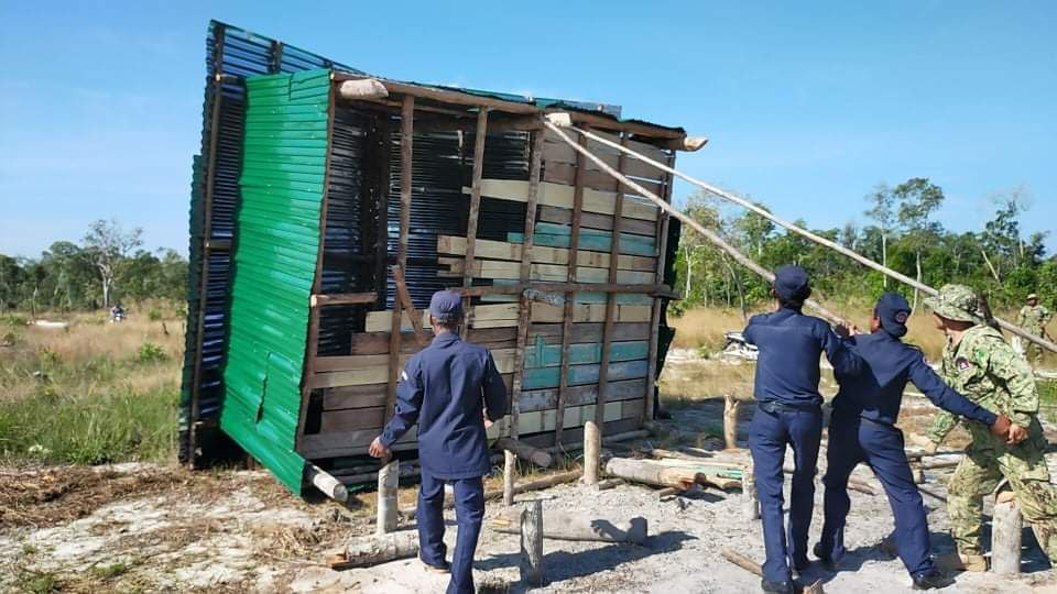 Local authorities and environmental officials destroy the house of a villager accused of building illegally in Botum Sakor National Park in Koh Kong province. The demolition took place on September 3. Photo Supplied