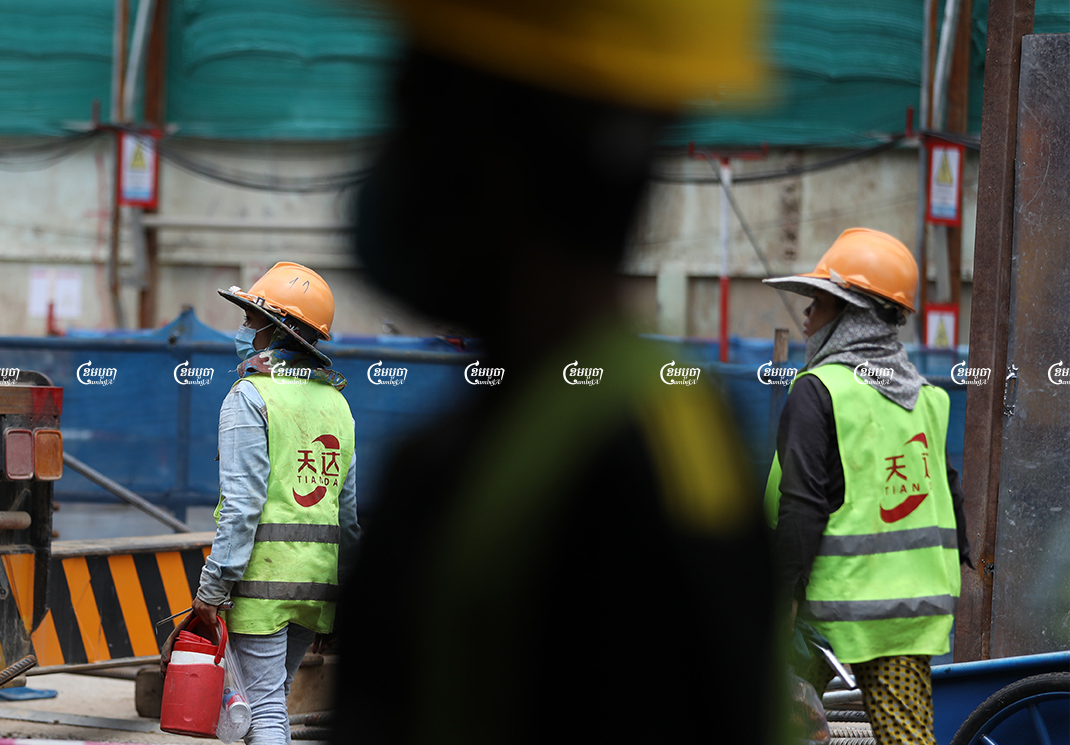 Laborers work at a construction site in Phnom Penh, Picture taken September 27, 2021. CamboJA/ Pring Samrang
