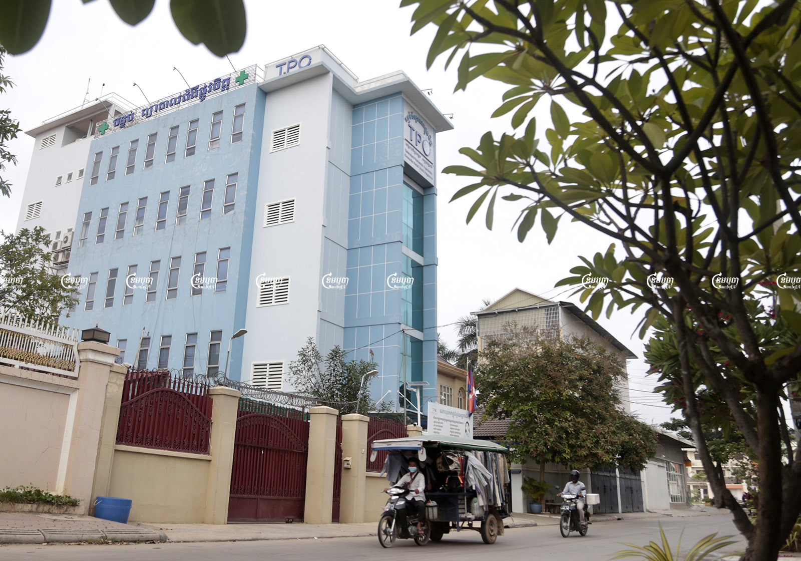 Motorists drive past the TPO building in Phnom Penh, August 28, 2021. CamboJA/ Panha Chhorpoan