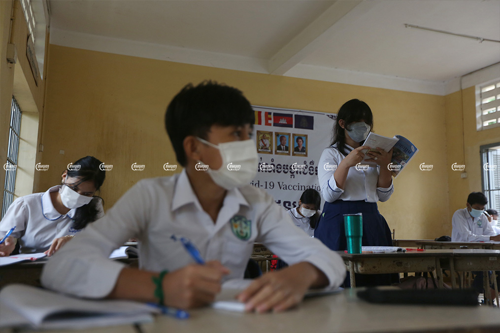 Students study in their classroom on the first day of their school's reopening in Phnom Penh on September 15, 2021. CamboJA/ Pring Samrang