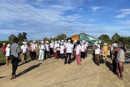 A journalist in the field covering a press conference held by villagers during an ongoing land dispute at the site of the massive planned airport in Kandal province on September 4, 2021. Photo Supplied