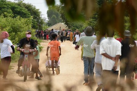Villagers gather to demonstrate in front of police barricades where authorities blocked a road leading to their farmland, which is being cleared to prepare the site for a planned airport in Kandal Stung district, Picture taken on September 12, 2021. CamboJA/ Panha Chhorpoan